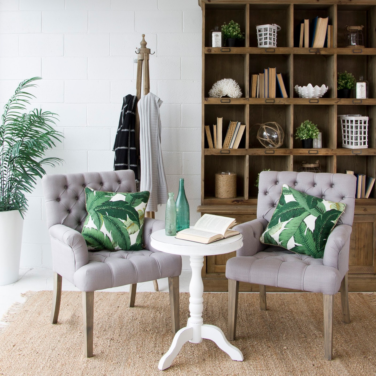 botanical pillows on chairs