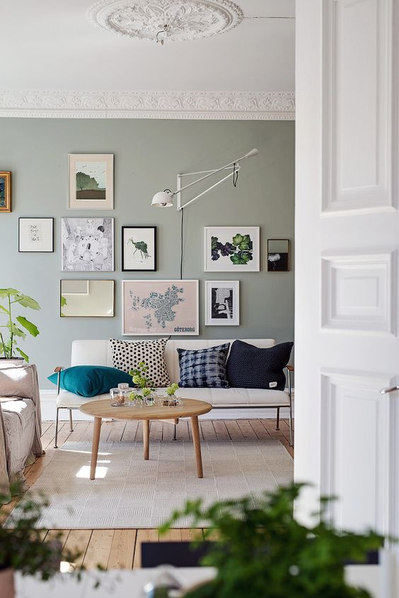 sage green walls with picture frames
