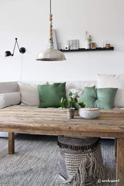 sage green pillows on a white couch