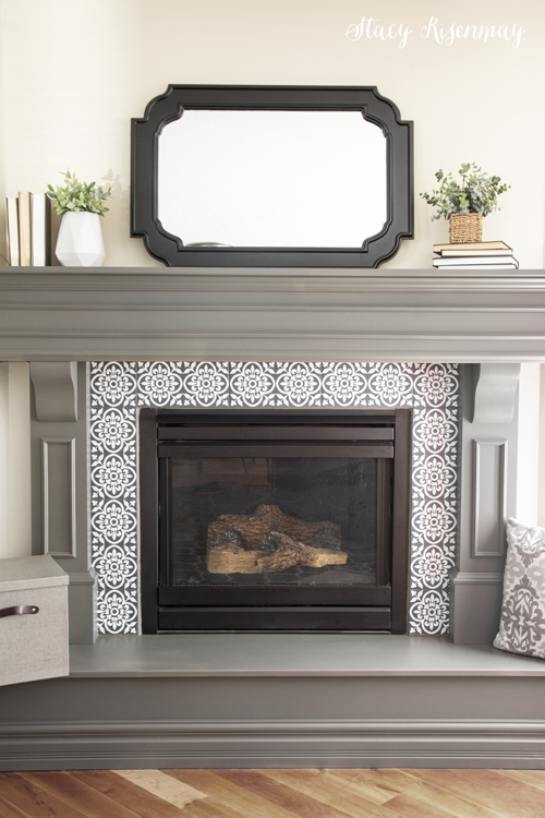 gray fireplace mantel and faux cement tiles