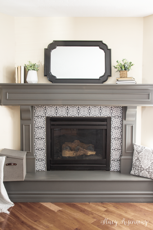 Gray fireplace mantel with mirror above